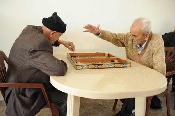 "5 - Two old men playing ""tawleh""."